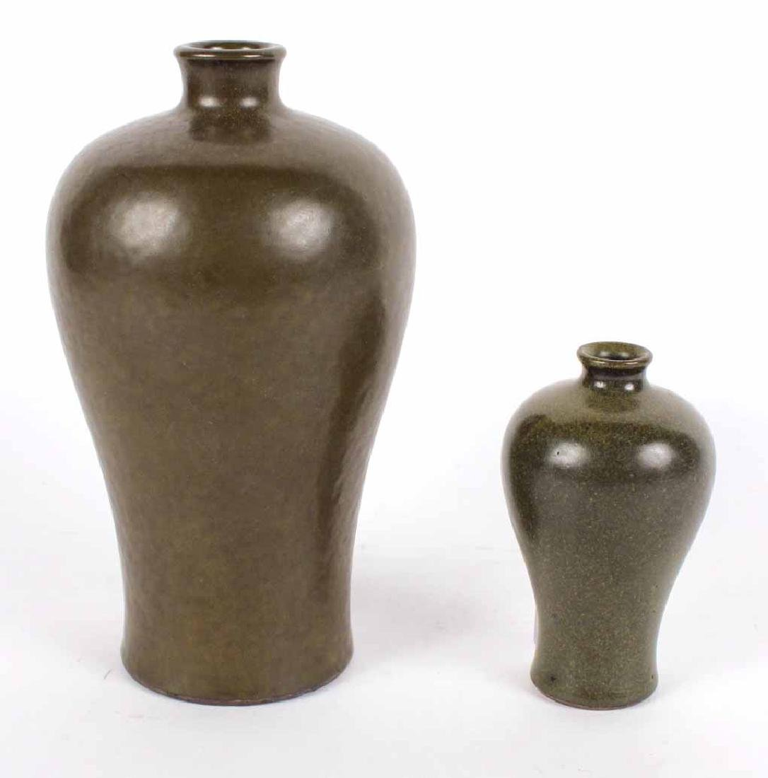 Two Glazed Dark Green Vases