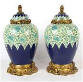Pair of Louis XV Style Porcelain Covered Urns