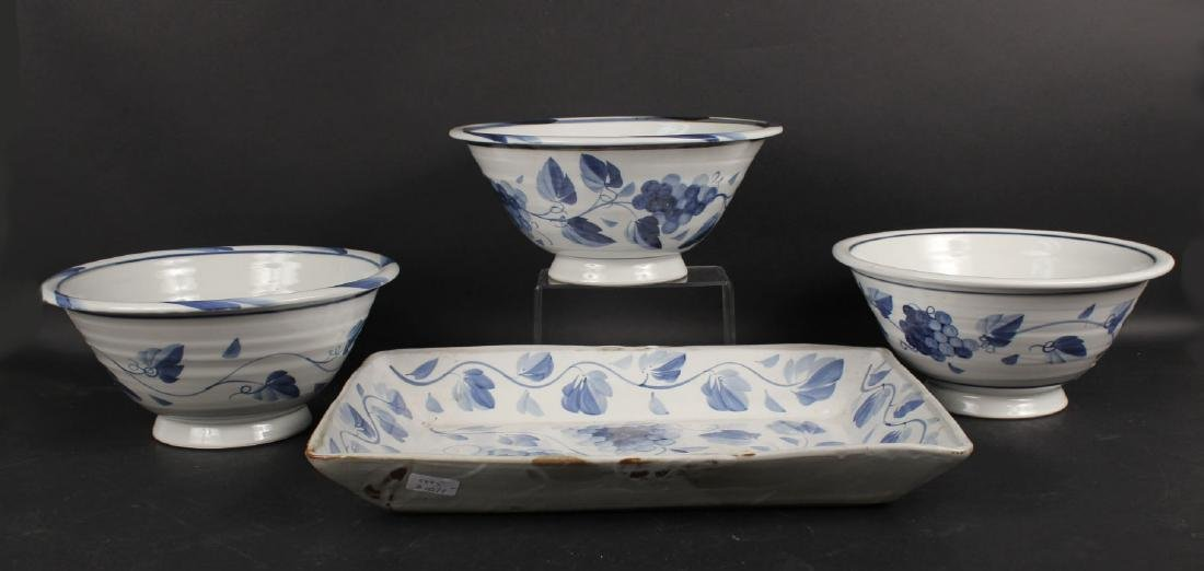 THREE BLUE AND WHITE DECORATED BOWLS