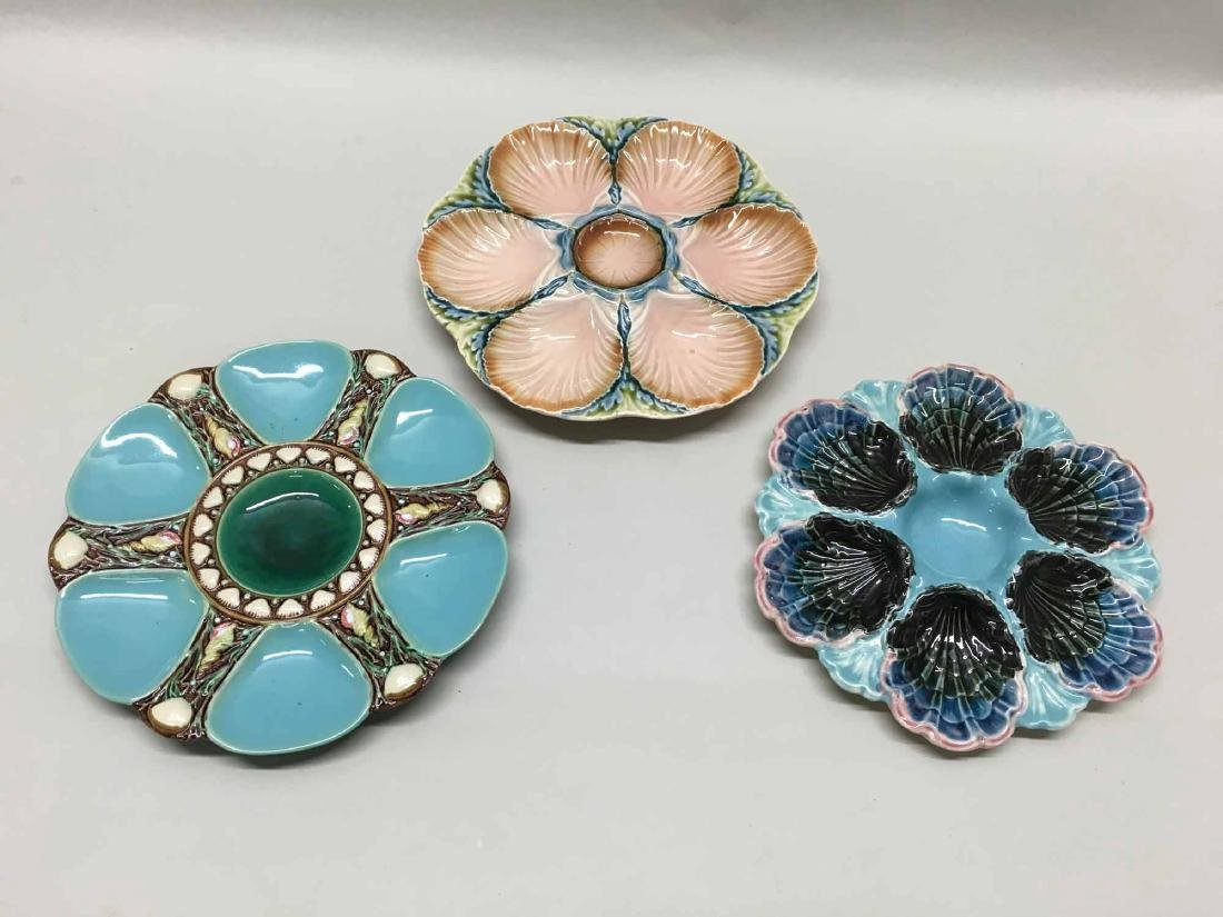 THREE ASSORTED MAJOLICA STYLE OYSTER PLATES