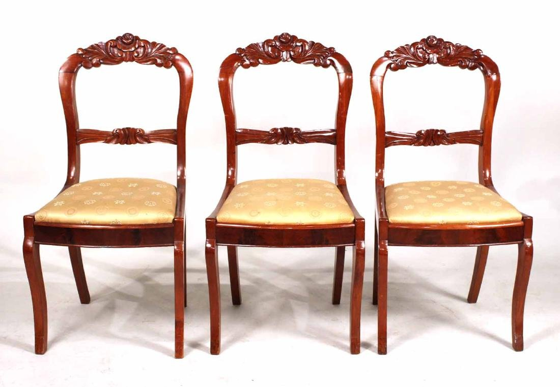 Three Victorian Carved Mahogany Side Chairs