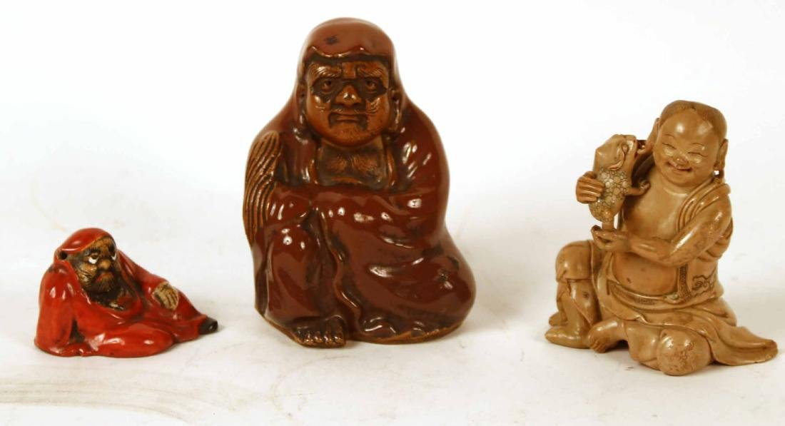Two Asian Ceramic Cloaked Figures