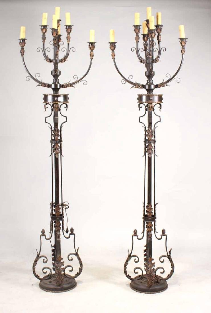 Pair of Patinated Iron Floor Torcheres