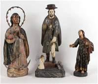 Two Santos Carved Wood Figures