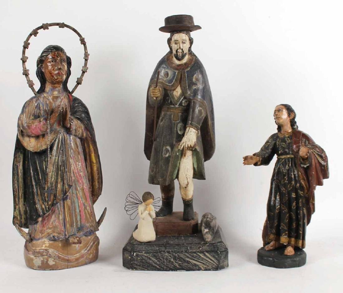 Two Santos Carved Wood Figures