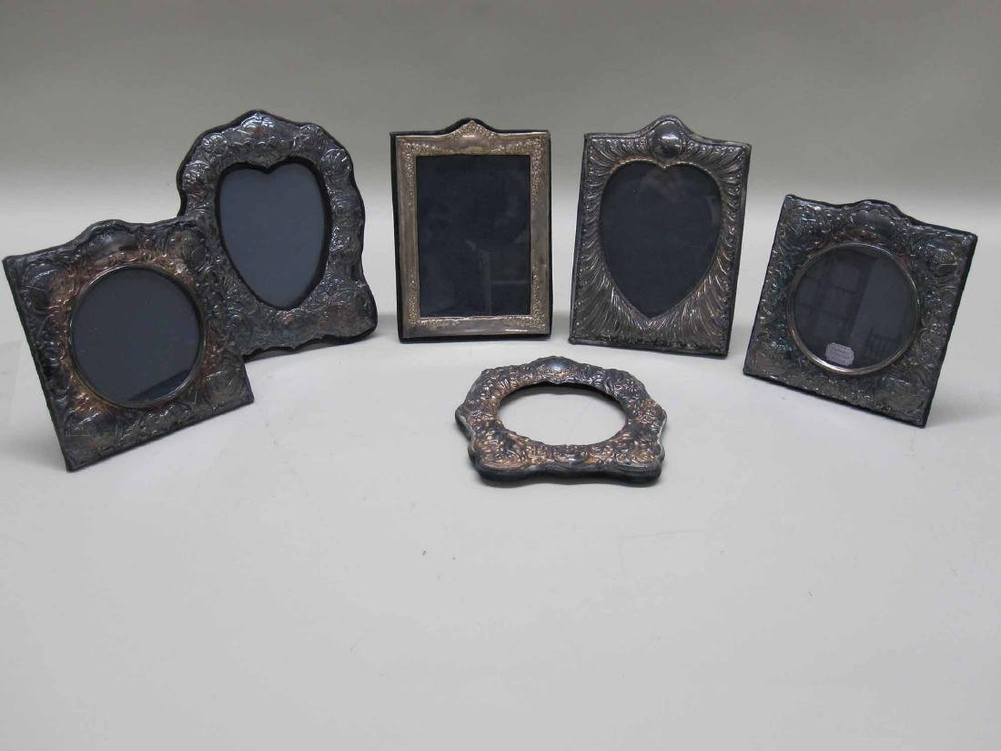SIX ASSORTED SILVER PICTURE FRAMES
