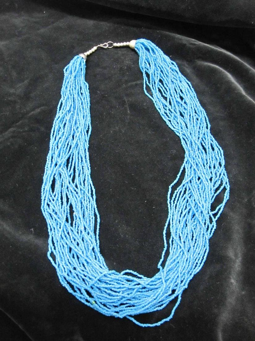 TWO MULTI-STRAND BEAD NECKLACES