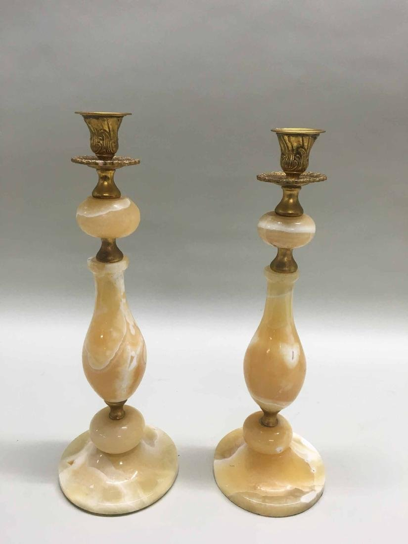 PAIR OF ONYX AND GILT METAL CANDLESTICKS