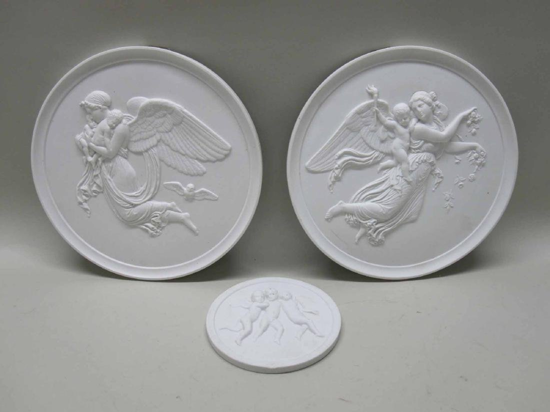 THREE NEOCLASSICAL BISQUE BAS RELIEF WALL PLAQUES