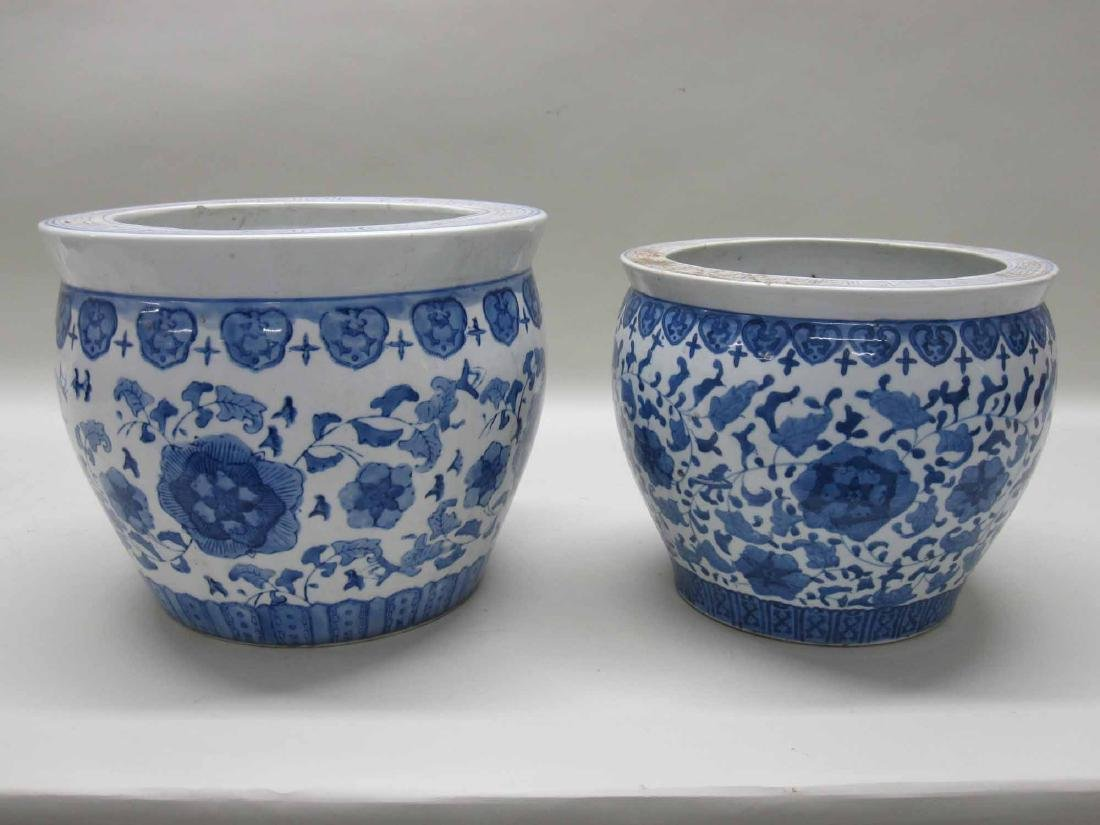 TWO CHINESE BLUE AND WHITE PORCELAIN CACHE POTS