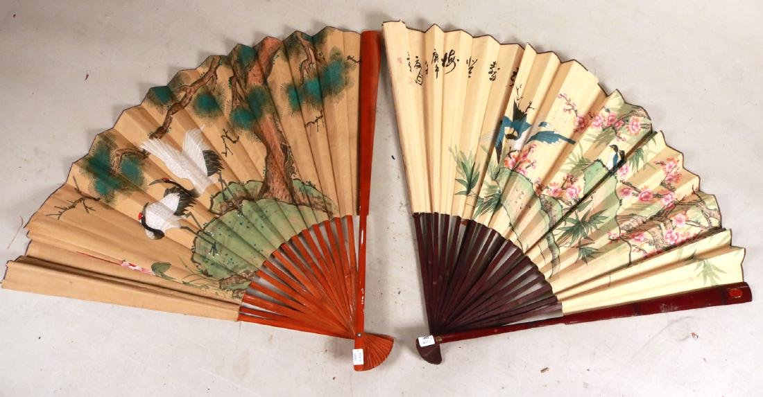 TWO LARGE ORIENTAL STYLE FANS