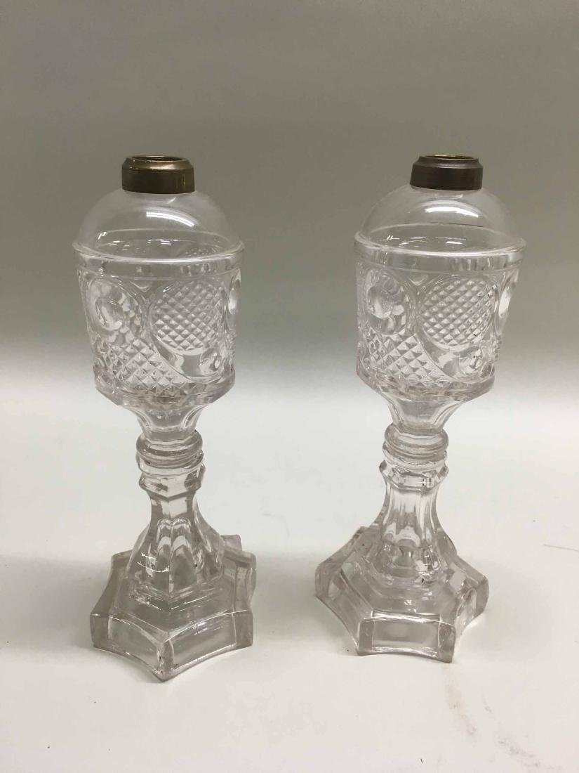 PAIR OF MOLDED GLASS OIL LAMPS