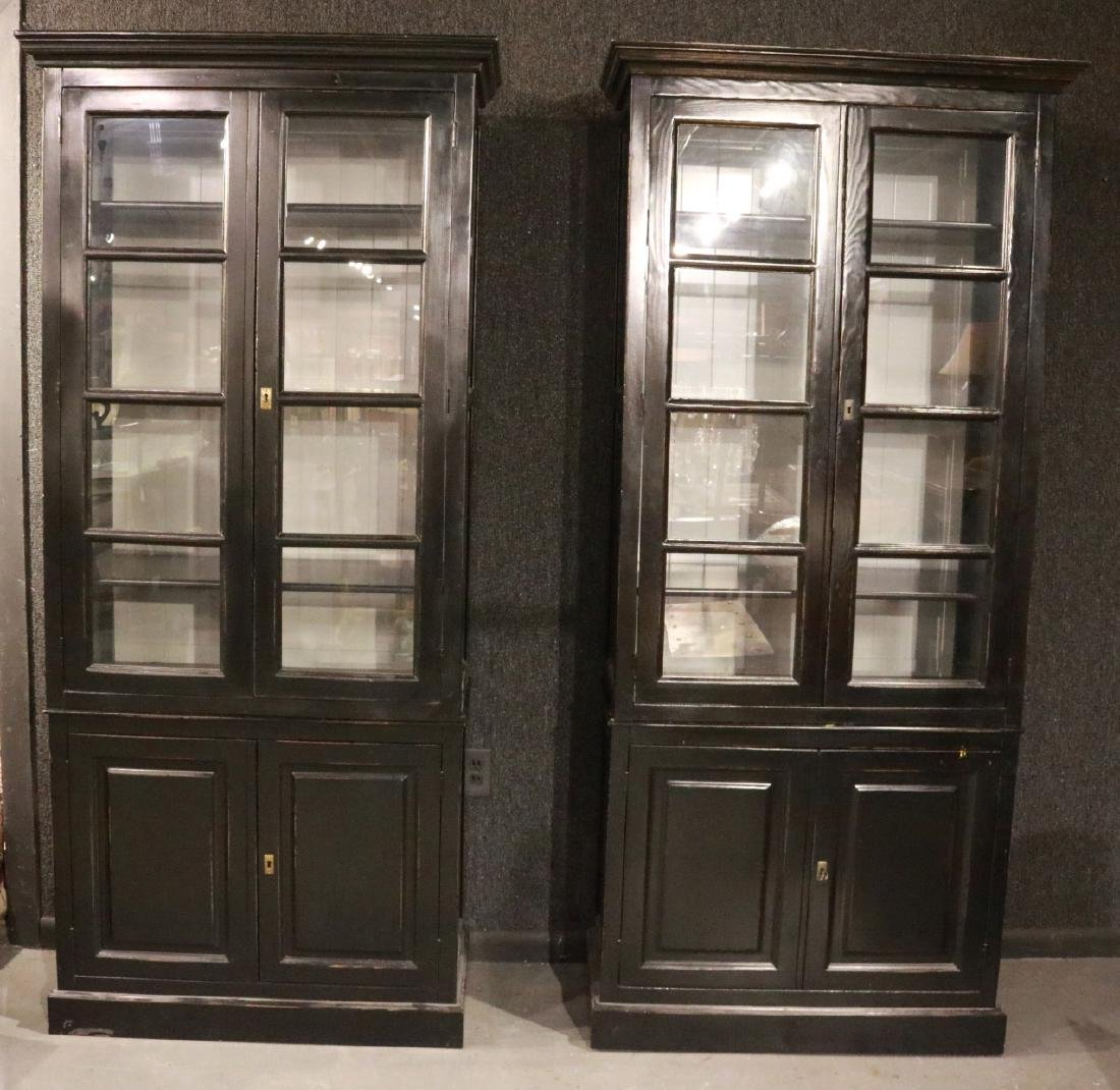 PAIR OF EBONIZED TALL DISPLAY CABINETS