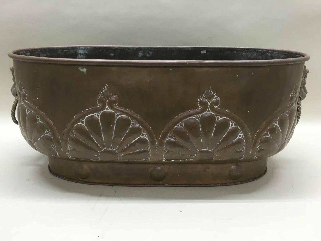 BRASS PLANTER WITH LION HEAD HANDLES