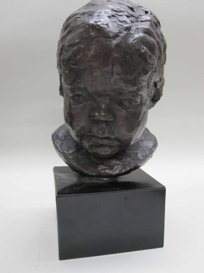 PATINATED METAL BUST OF A CHILD