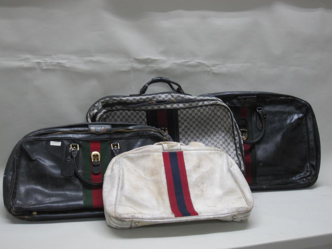 THREE VINTAGE GUCCI SUITCASES