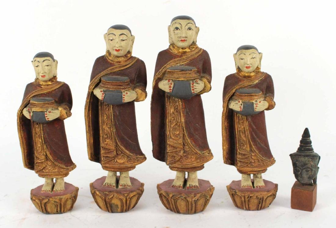 FOUR CARVED WOOD THAI MONK FIGURES