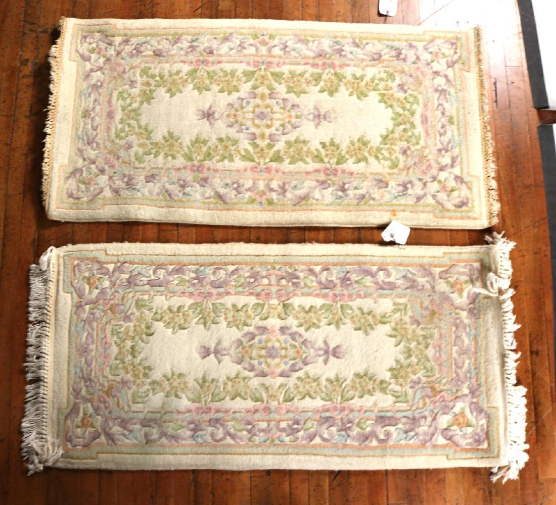 TWO CHINESE FLORAL-DECORATED THROW RUGS