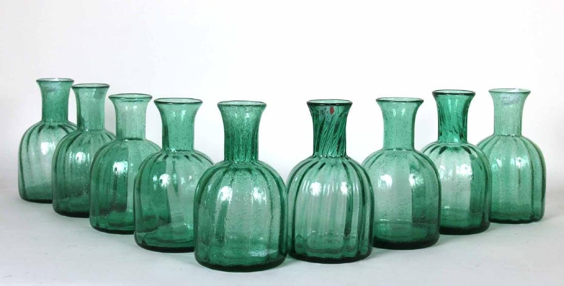 Nine Green Glass Decanters