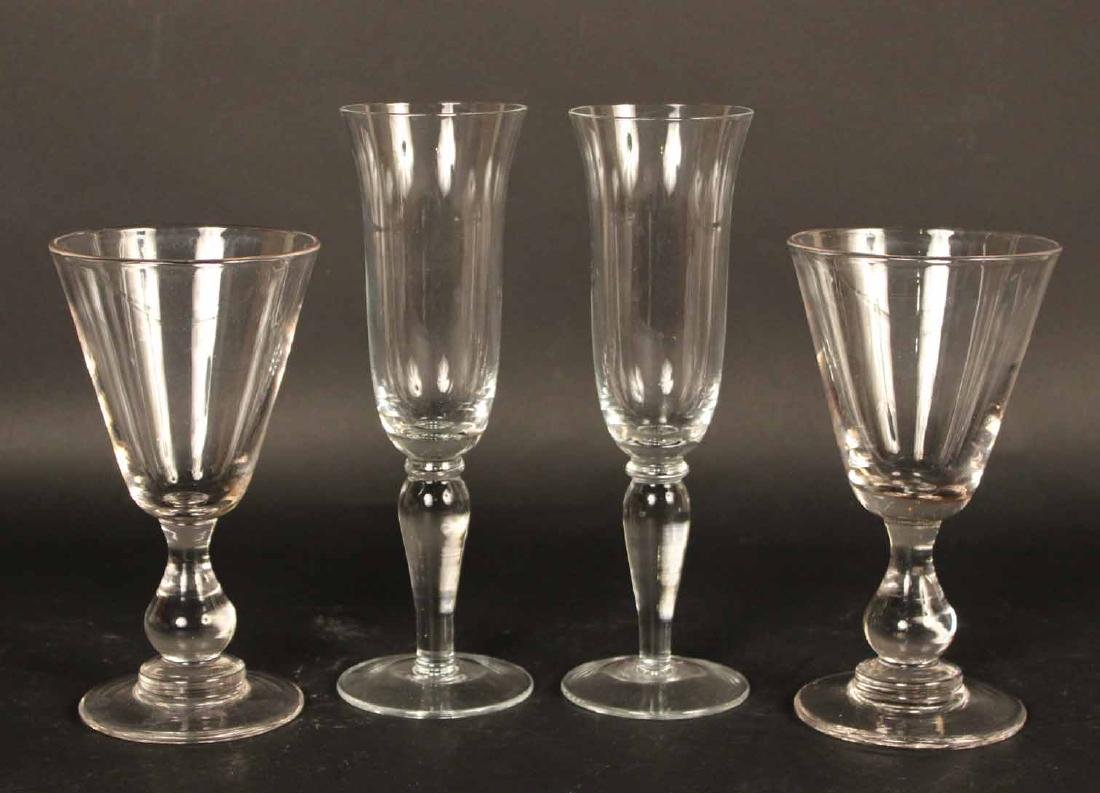 Colorless Glass Champagne Flutes and Goblets