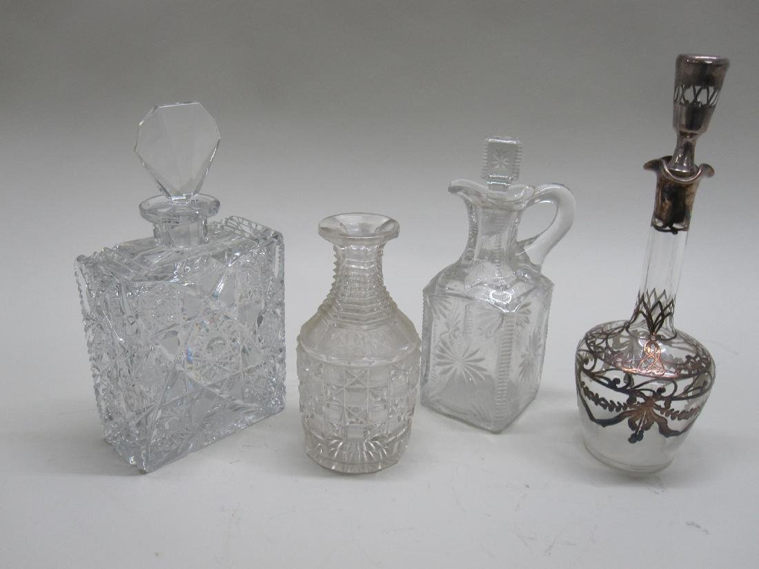 GROUP OF FOUR GLASS DECANTERS