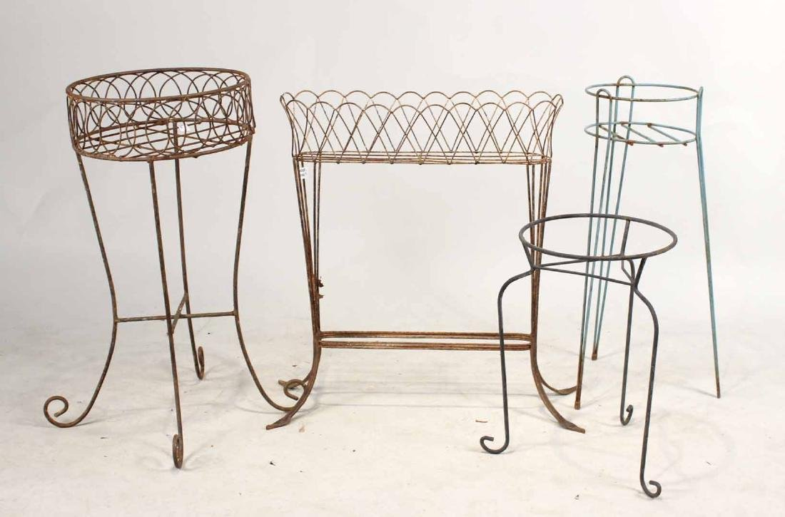 FOUR METAL PLANT STANDS