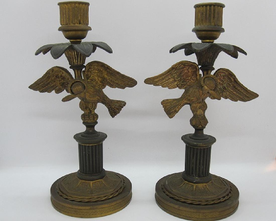 PAIR OF BRASS EAGLE FORM CANDLESTICKS