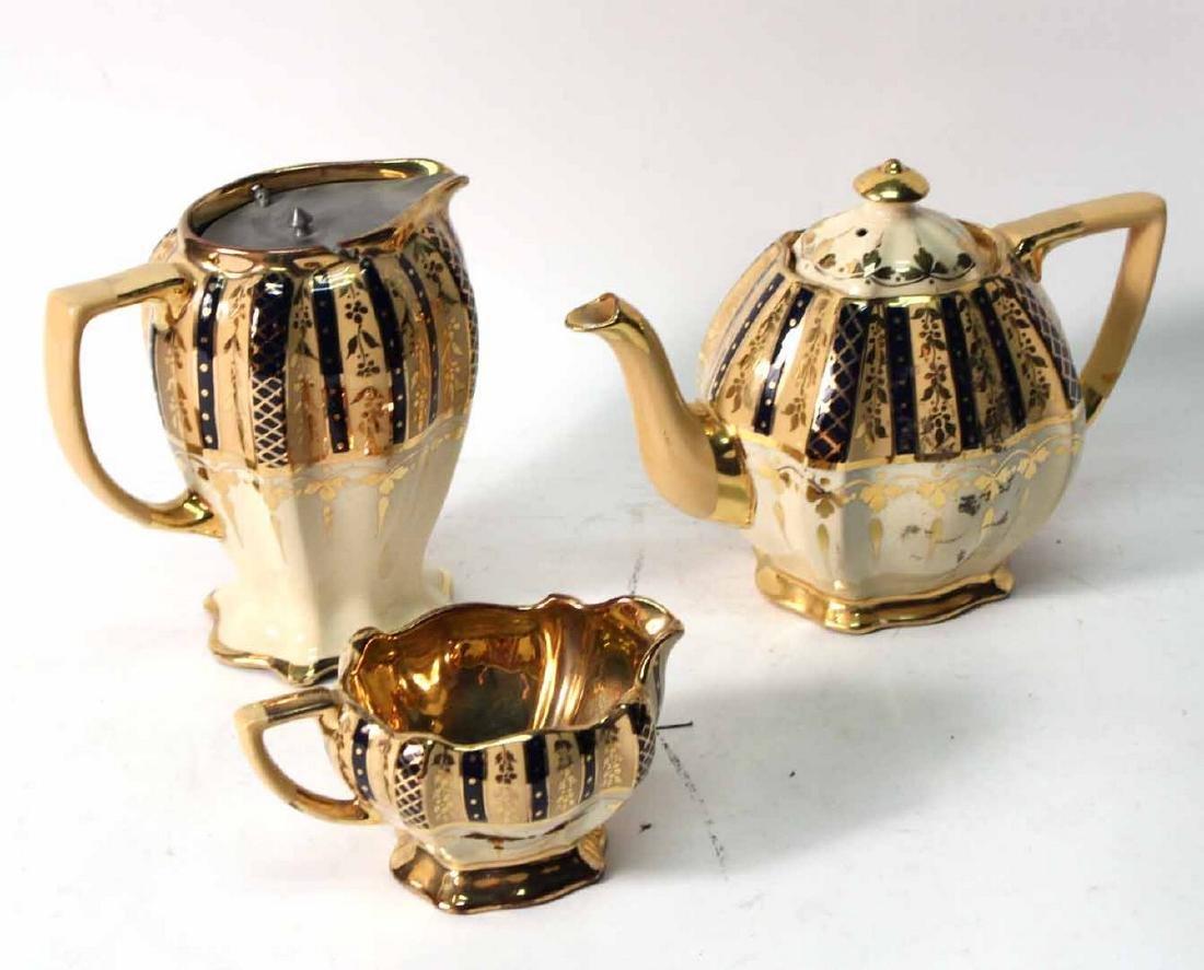 Parcel-Gilt and Cobalt Decorated Tea Service
