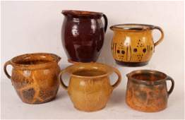 Group of Slip-Decorated Redware Pitchers