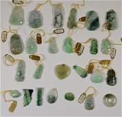 Twenty Two Carved & Polished Jade Pendants