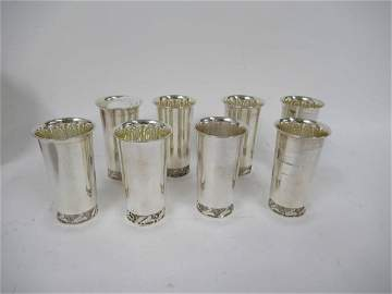Eight Georg Jensen style 950 sterling cups