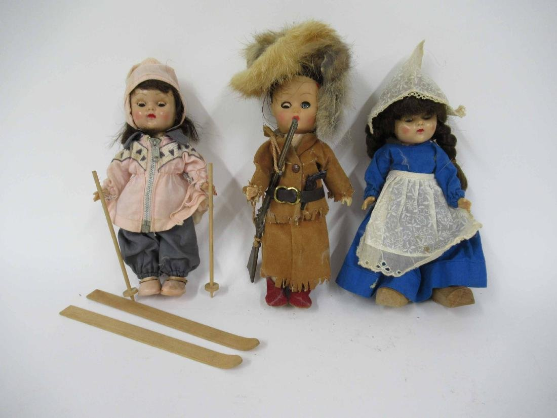 Group of assorted vintage dolls and clothing