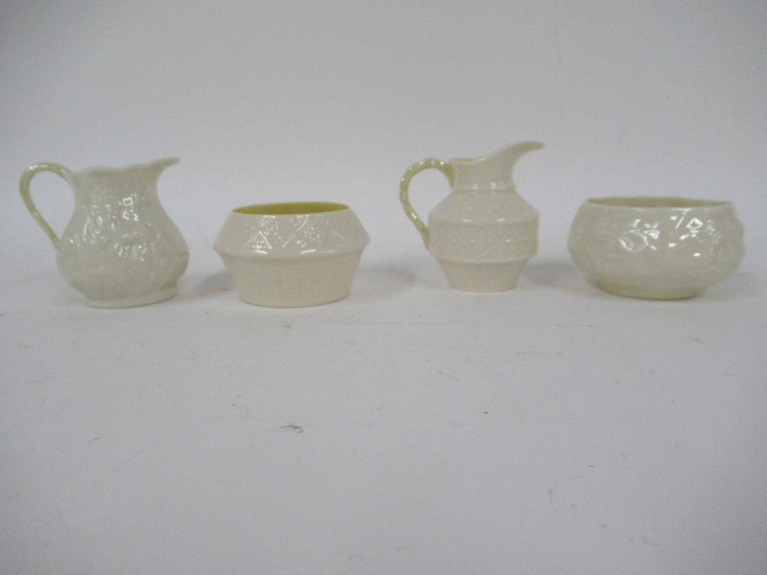 TWO SETS OF BELLEEK CREAMER AND SUGARS