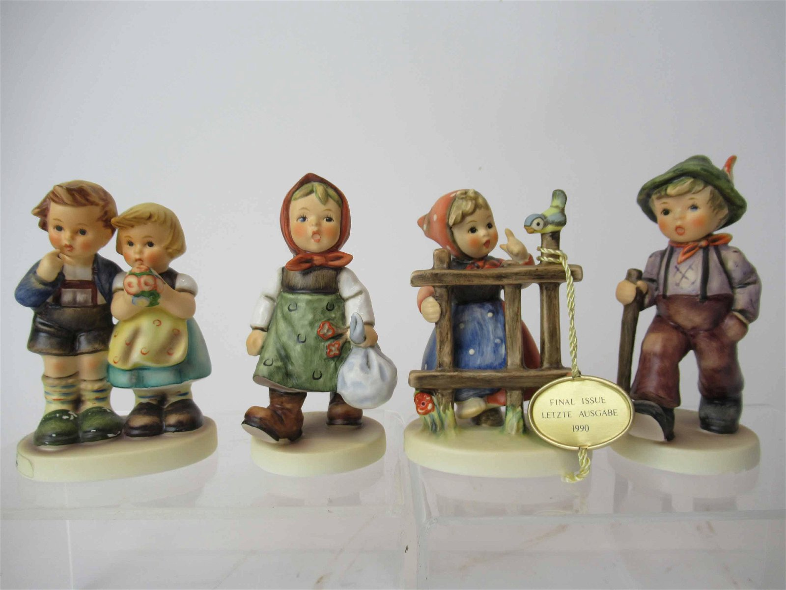Four M. J. Hummel Goebel Figurines