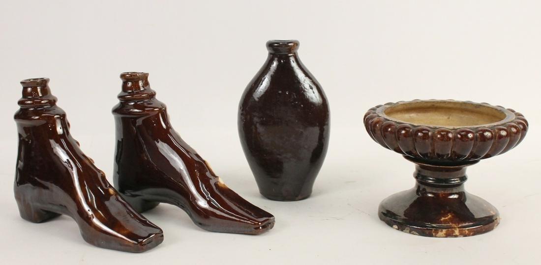 Two Rockingham Pottery Shoe Form Flasks