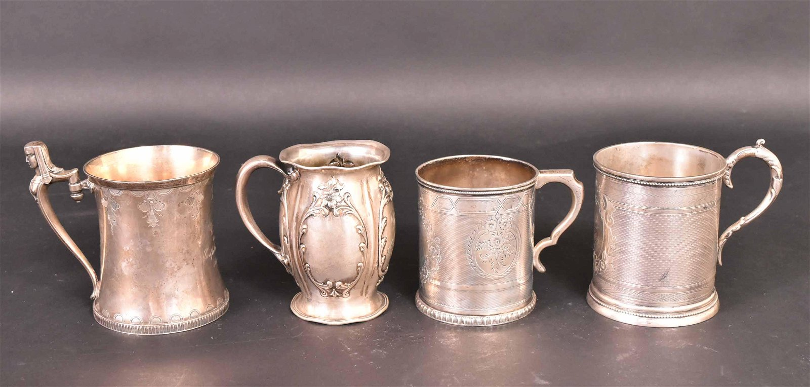 Four Sterling Handled Cups