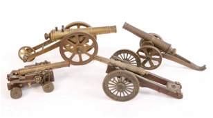 Four Brass and Wood Toy Cannons