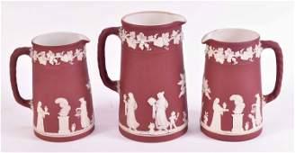Three Wedgwood Crimson Jasperware Pitchers
