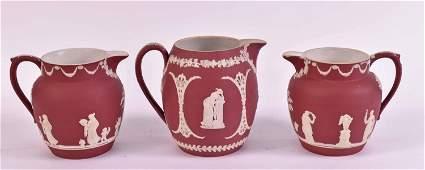 Three Wedgwood Crimson Jasperware Cream Jugs