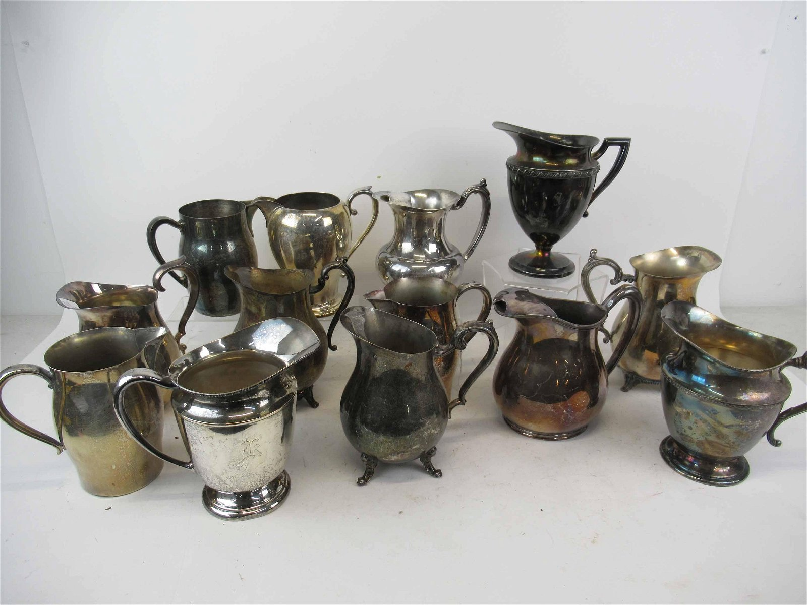Group of Assorted Silver Plated Water Pitchers
