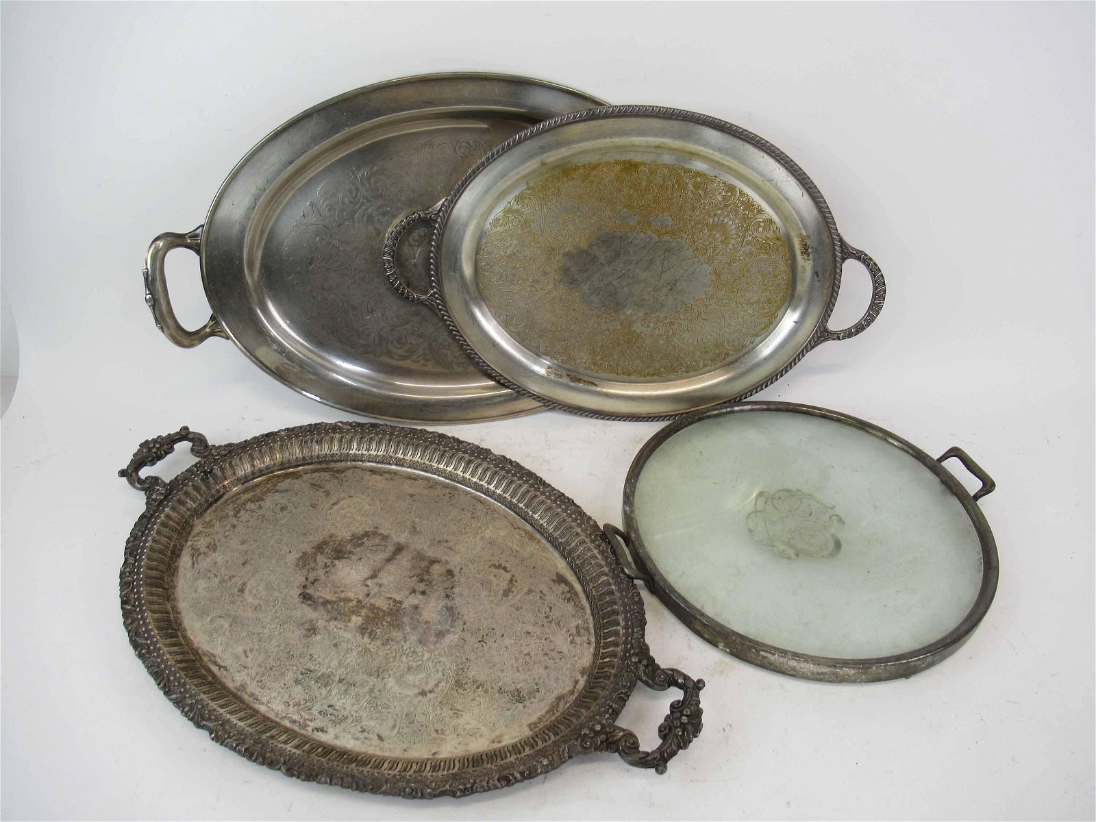 Group of 4 Assorted Silver Plated Serving Trays