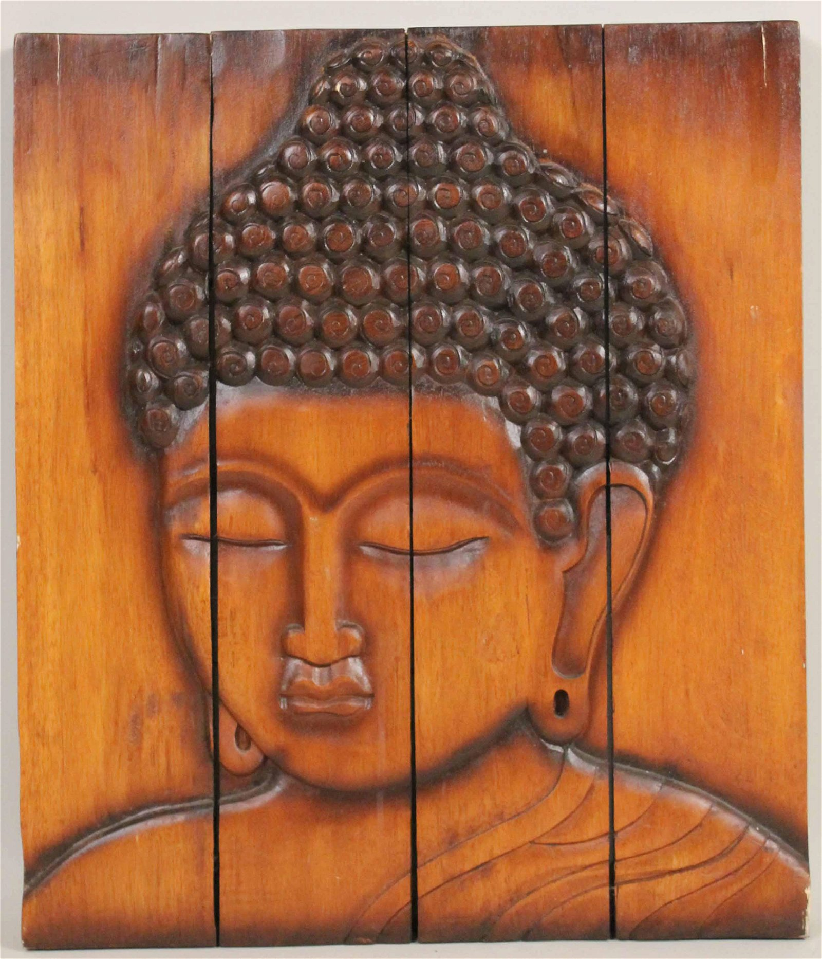 Carved Wood Plaque of a Deity Head