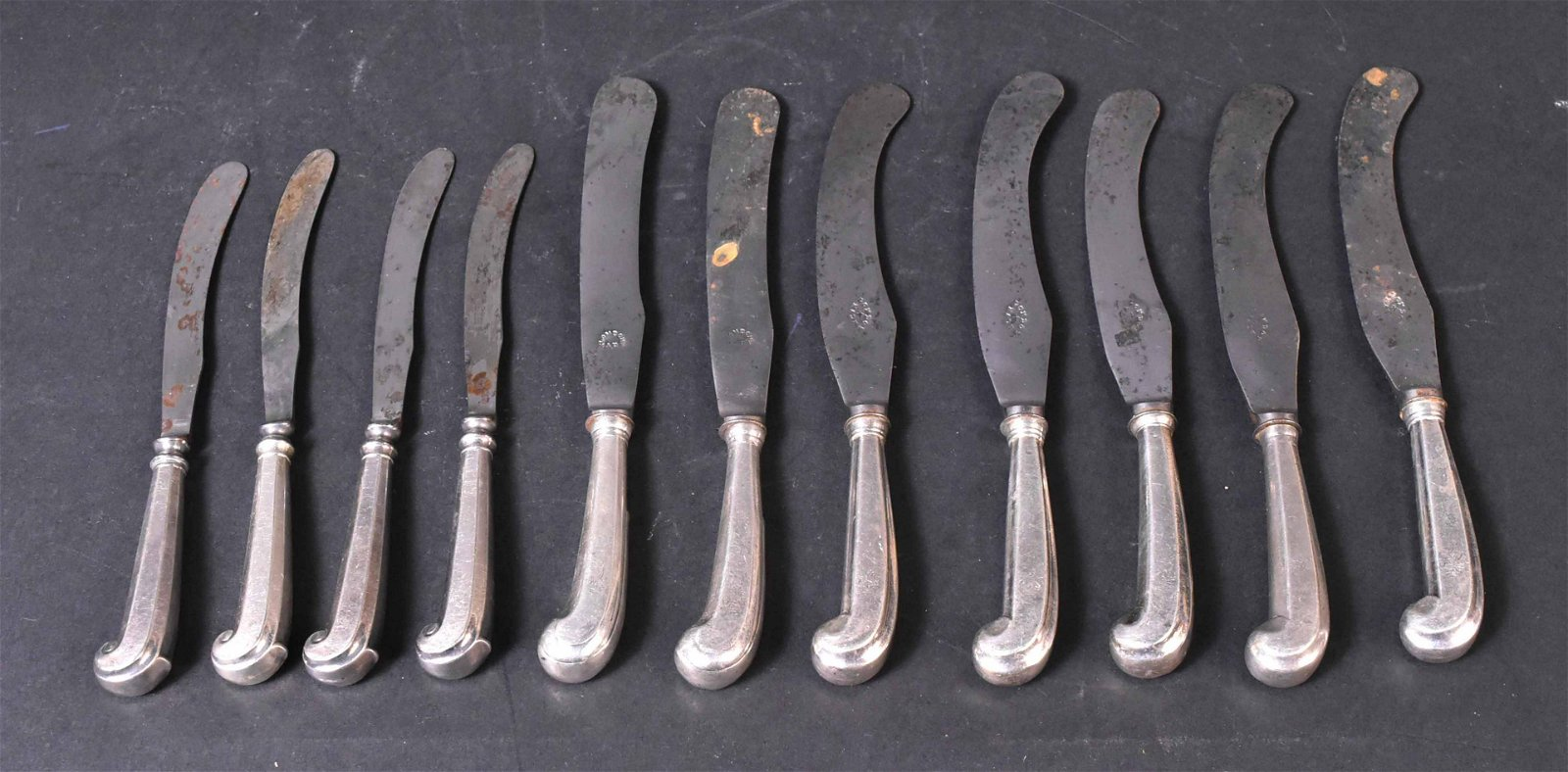 Eleven English Silver Pistol Handled Knives
