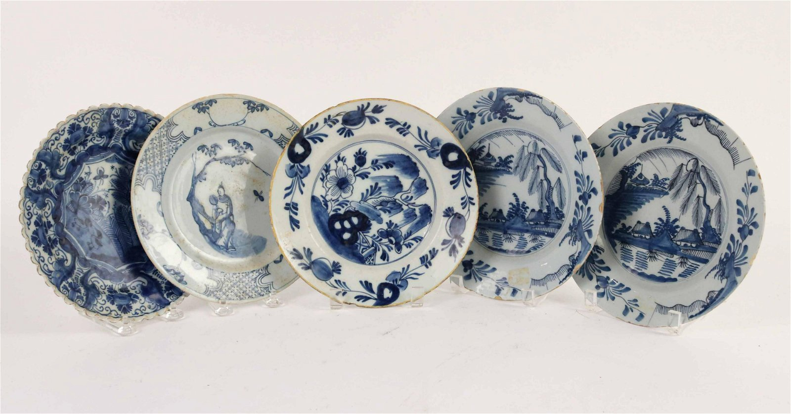 Five Blue and White Tin Glazed Earthenware Plates