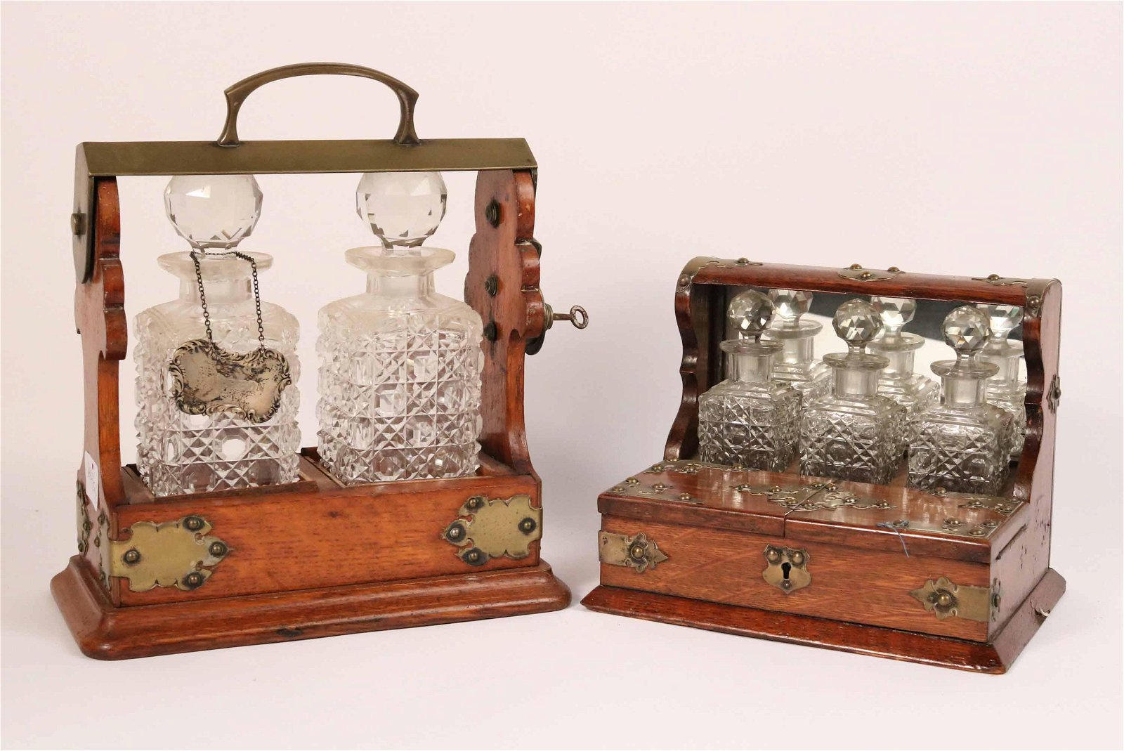 Two Victorian Brass Mounted Oak Tantaluses