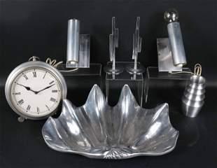 Seven Modern White Metal Table Articles