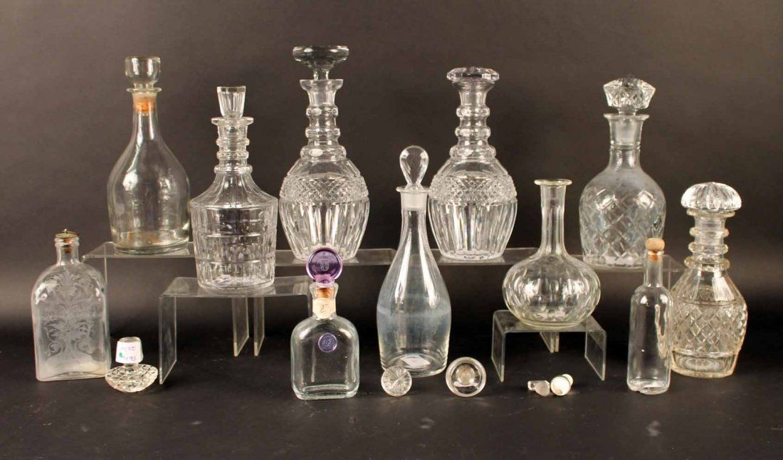 Eleven Glass Decanters and Associated Stoppers