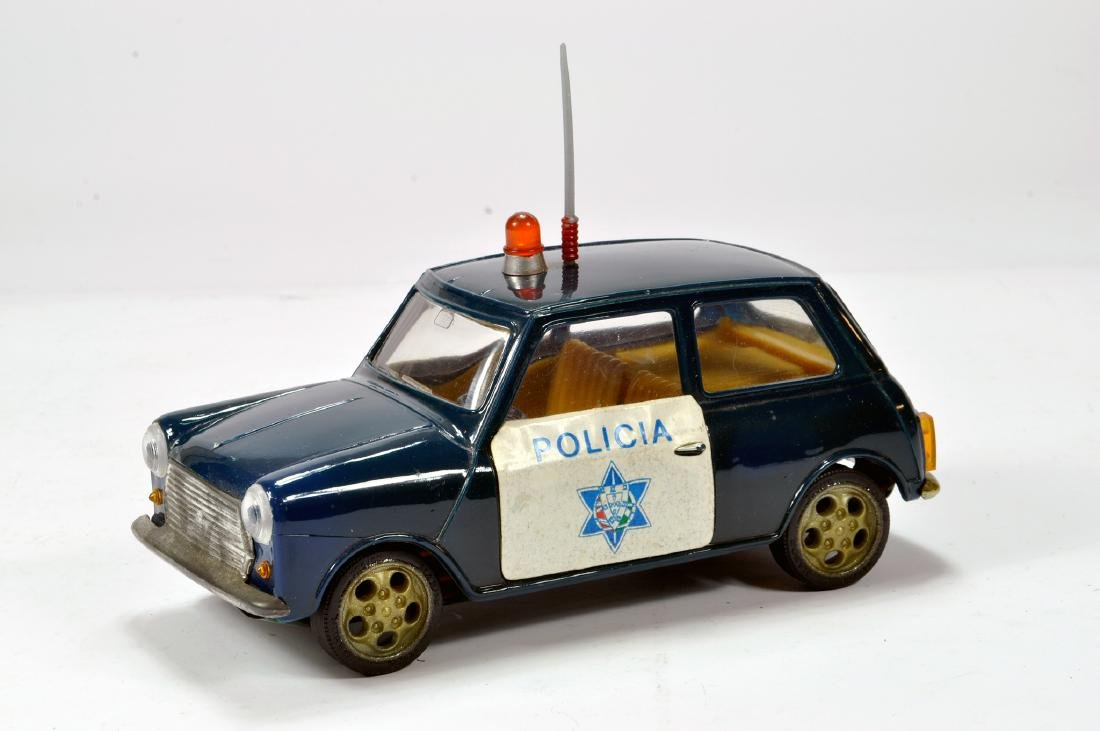 An approx 1/20 scale model of a Mini with Policia