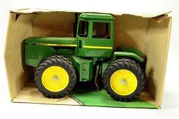 Ertl 1/16 John Deere four-wheel drive tractor.