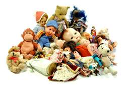 A misc group of old toys comprising dolls including